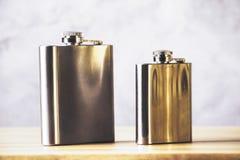 Flasks on wooden table Stock Photo