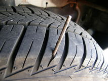 Flat. Tire with a nail Royalty Free Stock Photo