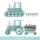 Flat agricultural tractor with trailer and plowing station Stock Photos