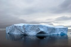 Flat antarctic icebrg. Tabular iceberg in Antarctica, with dark sea Royalty Free Stock Photos