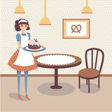 Flat bakery store interior with table, wooden chair and picture of pretzel on the wall. Smiling girl waitress holding Stock Photo
