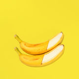 Flat banana background. Fresh bananas on yellow background, view from above Stock Photos