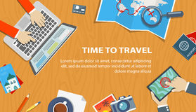 Flat banner of travel planning. Desktop with obiects and hands. Royalty Free Stock Photography