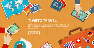 Flat banner of travel planning. Desktop with obiects and hands. Royalty Free Stock Photo