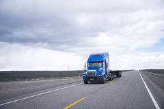 Flat bed semi-truck going to destination point for cargo Royalty Free Stock Images