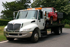 Flat Bed Tow Trck with Truck. White Flat Bed tow truck with Red Truck on bed Royalty Free Stock Photos