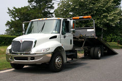 Flat Bed Tow Truck. Empty White Flat Bed tow truck
