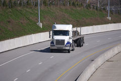 Flat Bed Truck. On the Highway Royalty Free Stock Images