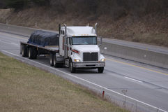 Flat Bed Truck. On the Highway Stock Photo