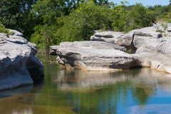 Flat bedrock in a stream bed Stock Photo