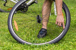 Flat bicycle tire. Repairing a flat bicycle tire Stock Photo