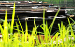 Flat boats on the backwater in summer Royalty Free Stock Photo