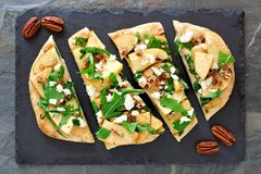 Flat bread with apples, arugula, above view on slate server Stock Photos