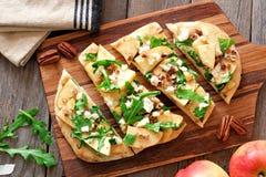 Flat bread with apples, arugula, overhead scene on wood server Royalty Free Stock Photo
