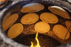 Flat bread in clay oven Royalty Free Stock Photo