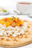 Flat bread with cottage cheese, honey, nuts, fresh peaches Stock Photos