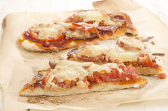 Flat bread pizza with tomato and salami Stock Images