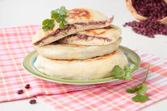 Flat bread with red beans and coriander Stock Images