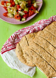 Flat bread and salad. On a fabric Stock Photos