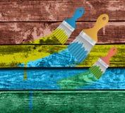 Flat brushes with paint's splashes Stock Photo