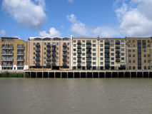 Flat Building along River Side Royalty Free Stock Photography