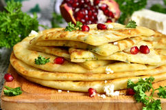 Flat cake with filling from potato,brynza and herbs. Stock Images