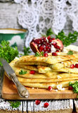 Flat cake with filling from potato,brynza and herbs. Royalty Free Stock Photography