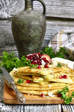 Flat cake with filling from potato,brynza and herbs. Stock Photos