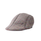 Flat cap in grey and brown tweed Royalty Free Stock Image