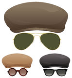 Flat cap sunglasses. A group of flat caps and various sunglasses Royalty Free Stock Photo