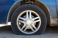 Flat Car Tire on Gravel Road Stock Photography