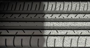 Tyre Tread Morphing To Asphalt Stock Images