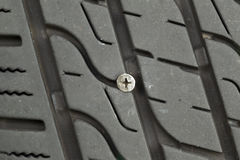 Flat Car Tire with wood screw imbedded in tread Royalty Free Stock Images