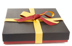 Flat cardboard gift box. On white, spanish flag colour laces Royalty Free Stock Photo