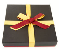 Flat cardboard gift box isolated. On white, laces in spanish flag colours Royalty Free Stock Photography