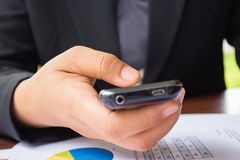 Flat cell phone in business man hand Royalty Free Stock Photography