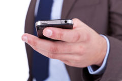 Flat cell phone in businessman hand Royalty Free Stock Images
