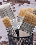 Flat Chip and Flat Cut Utility Paint Brushes   on wood stock image