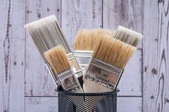 Flat Chip and Flat Cut Utility Paint Brushes   on wood royalty free stock image