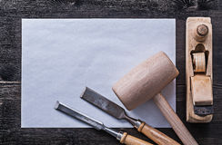 Flat chisels wooden hammer planer sheet of paper Royalty Free Stock Images