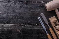 Flat chisels wooden mallet planer on wood board Stock Image