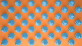 Flat colorful pop art composition with blue party cupcakes, bakery goodies, on orange background, pattern texture copy. Space stock photos