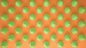 Flat colorful pop art composition with green party cupcakes, bakery goodies, on orange background, pattern texture copy. Space stock images