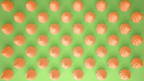 Flat colorful pop art composition with orange party cupcakes, bakery goodies, on green background, pattern texture copy space. Flat colorful pop art composition royalty free stock photography