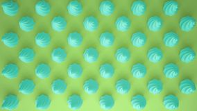 Flat colorful pop art composition with turquoise party cupcakes, bakery goodies, on green background, pattern texture copy. Space stock images