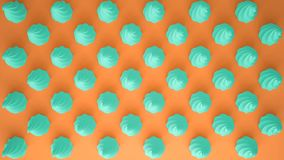 Flat colorful pop art composition with turquoise party cupcakes, bakery goodies, on orange background, pattern texture copy space. Flat colorful pop art stock images