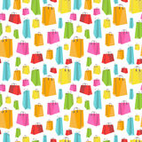 Flat colorful shopping bags on white seamless Royalty Free Stock Photography