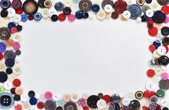 flat composition with buttons and sewing supplies on white background. Space for text stock image