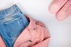Flat composition with a set of clothes in pink colors. Top view of clothes on a white background stock photography