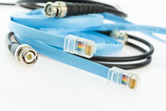 Flat console cables RJ45 and old BNC coaxial network cable Royalty Free Stock Photography
